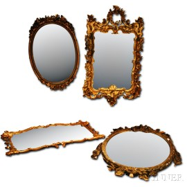 Four Large Carved Giltwood Mirrors.     Estimate $100-150