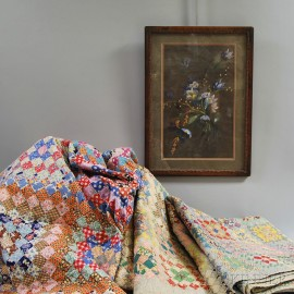 Three Patchwork Quilts and a Framed Pastel of Flowers