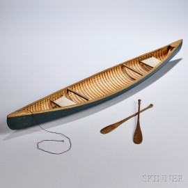 Miniature Canoe and Oars, early/mid-20th century, bentwood construction, with two woven seats, and carved oars, lg. 27 1/2 in.