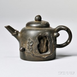 Yixing Teapot with Carved Sage Figure