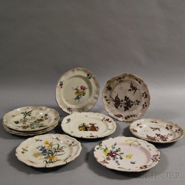Nine Faience Floral-decorated Plates