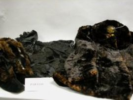 Six 19th Century Lady's Black Capes, Fur Jacket and a Pair of Fur-Trimmed Velvet   Boots