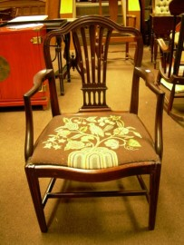 George III Style Carved Mahogany Armchair with Needlepoint Upholstered Seat.