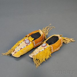 Pair of Kiowa Beaded Hide Man