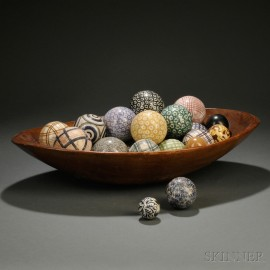 Collection of Ceramic Carpet Balls in an Oval Ash Bowl
