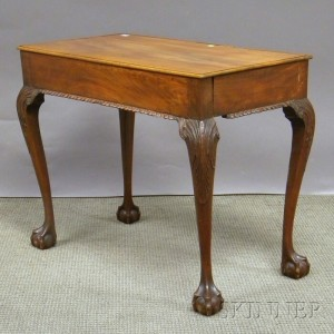 Sold for: $27,255 - Irish Chippendale-style Carved Mahogany Tea Table