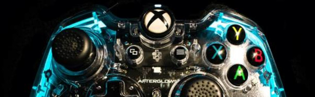 An Xbox videogame console controller, the edges glowing blue