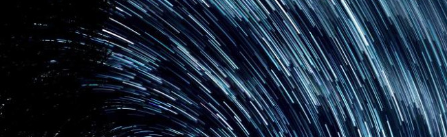 A picture of the night sky with long exposure, so stars appear as lines.