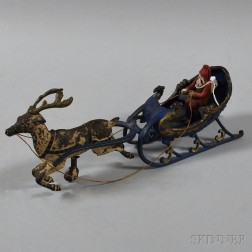 Vintage Polychrome-painted Cast Iron Santa Claus and Reindeer Toy