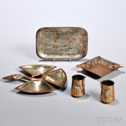 Five Mixed Metal Objects, Taxco, Mexico, 20th century, including two jiggers with spouts, an ashtray, a small three-part tray in the fo