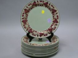 Set of Twelve Wedgwood Copper Lustre Decorated Ceramic Plates.