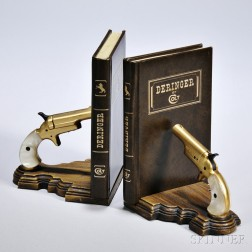 Colt Deringer Bookends, designed as leather-bound books and a pair of gold-plated pearl-handled single-shot pistols.