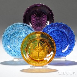 Four Assorted Colored Pressed Lacy Glass Cup Plates