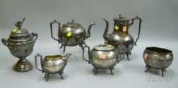 Five-piece Victorian Egyptian Revival Silver Plate Tea Set and a Silver Plated Covered Sugar Urn.