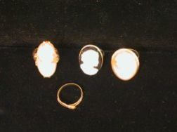 Three Cameo Rings and a Victorian Snake Ring.