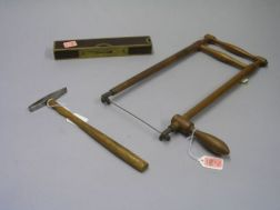 Small Maple Saw, a Millers Falls Co. Rosewood and Brass Level, and a Warner & Noble Tack Hammer.