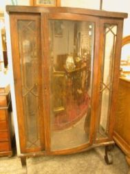 Oak China Cabinet with Bowed Glass Door.