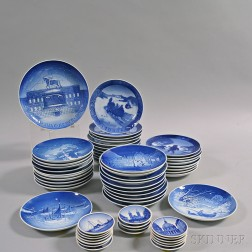 Sixty Royal Copenhagen and Bing & Grondahl Christmas Plates and Saucers.     Estimate $250-350