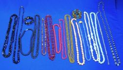 Fifteen Strands of Glass Bead Necklaces and Two Coiled Glass Bead Bracelets.