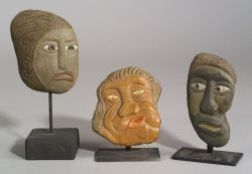 Three Polychrome Painted Carved Stone Heads