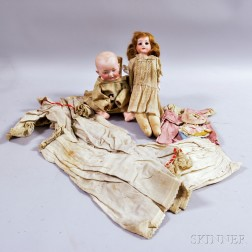 Two Bisque Dolls with Clothes.     Estimate $400-600