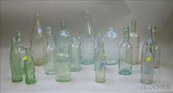 Sixteen Colorless and Aqua Glass Beverage and Spring Water Bottles