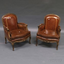 Pair of Louis XV-style Leather-upholstered Oak Bergeres