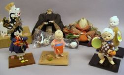 Seven Japanese Dolls, an Asian Carved and Painted Wooden Figure of a Man, and an Ink Stone in Wooden Box.