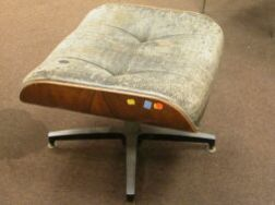 Wassily Chair and an Eames Ottoman.