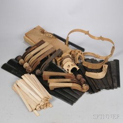 Two Boxes of Violin Wood, Bridges, Scrolls, Ribwood, and Fingerboards.     Estimate $100-200