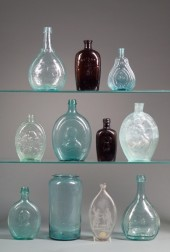 Eleven Aqua, Amber, and Olive Blown and Molded Glass Whiskey Flasks, and Calabash Bottles.