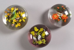 Three Rick Ayotte Glass Paperweights