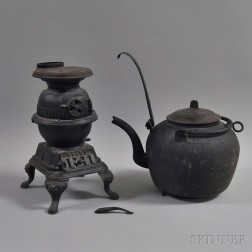 Spark Cast Iron Potbelly Stove and an Iron Kettle