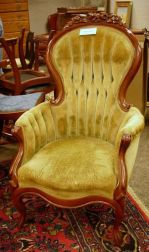 Two Victorian Rococo Revival Upholstered Carved Walnut Parlor Armchairs.