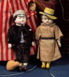 Pair of  Early Papier-Mache Boy and Girl Squeakers