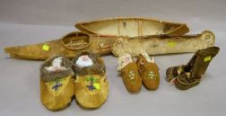 Two Native American Birch Bark Canoes, and a Hide Kayak Models, and Three Pairs of   Hide and Skin Moccasins