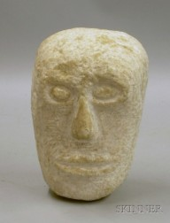 Relief-carved Stone Head