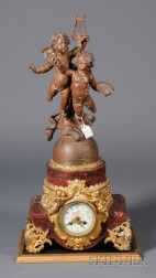 Louis XV/XVI-style Rouge Marble, Patinated and Parcel Gilt Metal Mantel Clock
