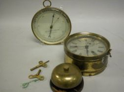Seth Thomas Brass Ships Bell Clock and an Aitchison & Co. Brass Barometer.