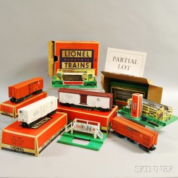 Six Lionel Train Cars and Accessories