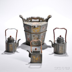 Three Pewter Teapots and an Inlaid Pewter Container
