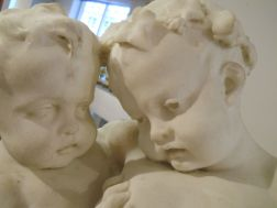 Benoît Rougelet (French, 1834-1894)       White Marble Sculpture DepictingThree Bacchanalian Putti
