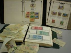 Three Partial Albums of United States Stamps and a Group of Foreign Stamps