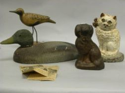 Homer Lawrence Carved and Painted Wooden Shore Bird, Painted Cast Iron Cat and Spaniel Doorstops and a Painted Wooden Duck Decoy.