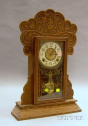 E. Ingraham & Co. Pressed Oak Gingerbread Shelf Clock.