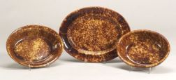 Two Rockingham Glazed Oval Baking Dishes and an Oval Platter