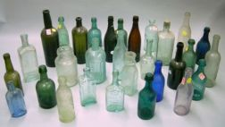Collection of Approximately Sixty-nine Mostly Aqua Glass Bottles, Insulators, Etc.