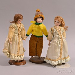 Three Small Bisque Lady Dolls