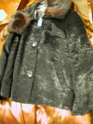 Three Fur Coats and Stole, Ostrich Trimmed Mink Stole, Fur Trimmed Coat, Cape and a Fox Hat.