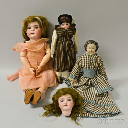 Three Bisque and Composition Dolls, a Bisque Doll Head, and a Trunk of Doll Clothing.     Estimate $200-300